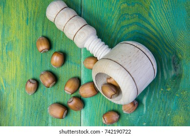 Nutcracker with nuts on a wooden background.