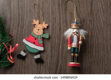 nutcracker and santa claus on wooden background, christmas decoration