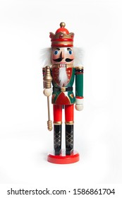 Nutcracker Wearing A Old Military Style Uniform. A traditional figurine of Christmas time over white background.