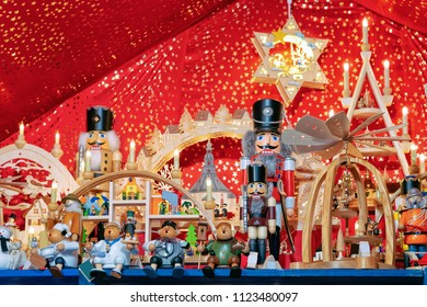Nutcrackers at Christmas Market at Gendarmenmarkt in Winter Berlin, Germany. Advent Fair Decoration and Stalls with Crafts Items on the Bazaar.