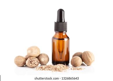 Nutmeg essential oil isolated on white background. Nutmeg oil for massage