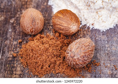 Nutmeg and flour. Ingredients for preparing bechamel sauce on wooden table. Close up