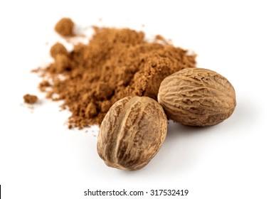 nutmeg and ground nutmeg on white background