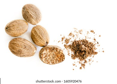 Nutmeg isolated.  Whole nut and grated nutmeg powder, top view, over white background.