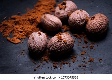 Nutmeg on dark background, directly above,