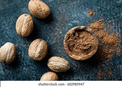 Nutmeg on dark background, directly above, copy space
