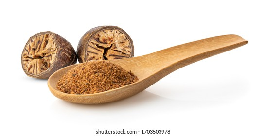 Nutmeg powder in wood spoon isolated on white background