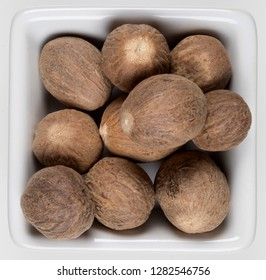 Nutmeg - used for flavoring many types of dishes, and nowadays is mostly found in western supermarkets in ground or grated form. Whole nutmeg can also be ground at home.