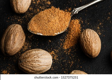 Nutmegs and ground nutmeg on a spoon