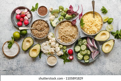 Nutrient rich foods cooked quinoa amaranth pearl barley dish on table with variety vegetables herbs seeds nutrient rich balanced food concept