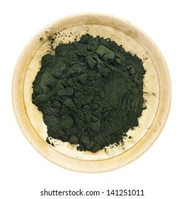 Nutrient-rich organic chlorella powder on a small ceramic bowl, isolated on white, top view
