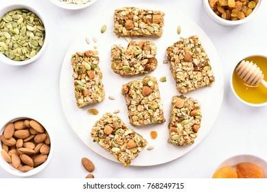 Nutrition bar, granola on wooden board. Healthy breakfast. Top view, flat lay.