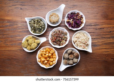 Nutrition concept - Healthy meals in white bowls over wooden background. Healthy food, Diet, Detox, Clean Eating or Vegetarian concept. Top view sets.