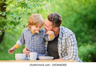 Nutrition habits. Family enjoy homemade meal. Family time. Nutrition kids and adults. Little boy and dad eat. Everything is more fun with father. Organic nutrition. Healthy nutrition concept.
