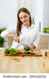 Nutrition. Woman Cooking Healthy Food In Kitchen.