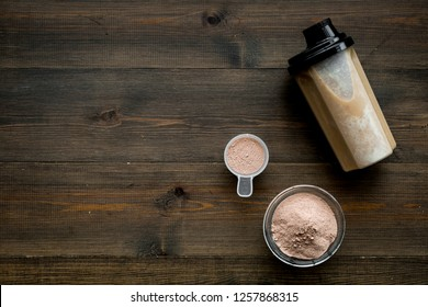 nutrition for workout with protein cocktail on wooden background top view mockup