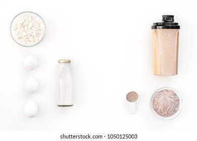 nutrition for workout with protein cocktail, powder, eggs and milk on white background top view mockup