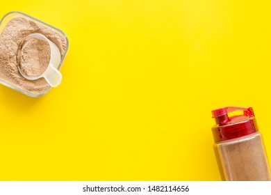 Nutrition for workout with protein cocktail powder and shaker on yellow background top view mockup
