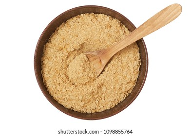 Nutritional brewers yeast flakes in wooden bowl isolated on white background. Top view