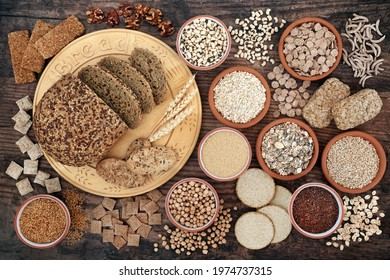 Nutritional health food with high fibre content with grain, legumes, seeds, nuts,  cereal foods also high in antioxidants, minerals, vitamins  smart carbs. Health care concept on rustic wood.