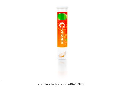 Nutritional supplement. A tube package of vitamin C effervescent tablets isolated on white background.