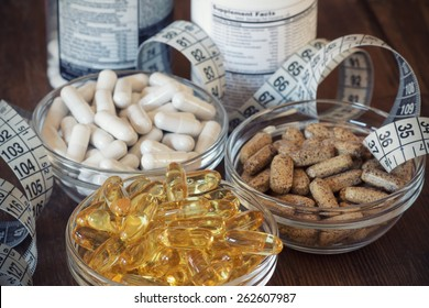 Nutritional supplements in capsules and tablets. Selective focus, shallow DOF