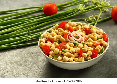 Nutritional vegan  super food - chickpeas garbanzo fresh salad mixed with exotix herbs and oilve oil.