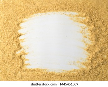 Nutritional yeast on white background. Nutritional inactive yeast top view. Copy space. Nutritional yeast is vegetarian superfood with cheese flavor, for healthy diet