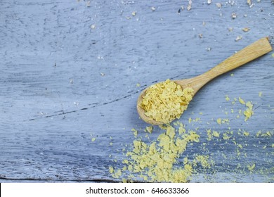 Nutritional Yeast on Wooden Background