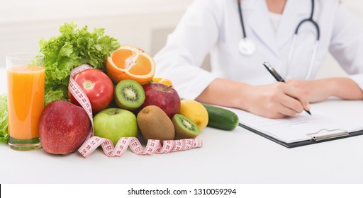 Nutritionist writing about vegetable diet benefits, panorama