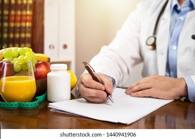 Nutritionist writing diet plan, dietician consultation, health