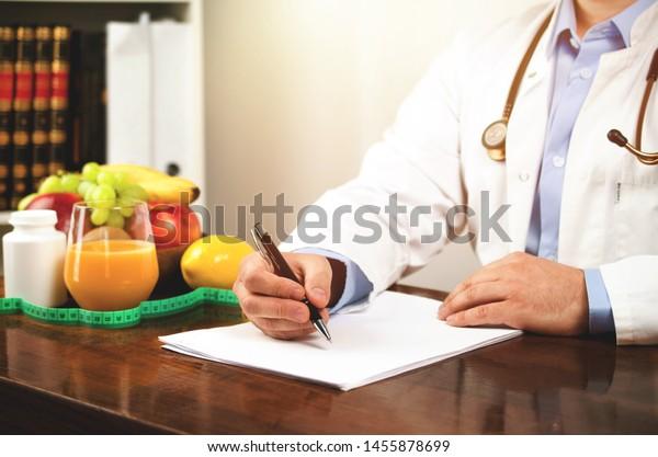 Nutritionist writing diet plan, nutrition