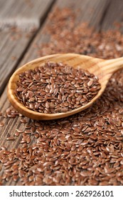 Nutritious flax seeds super foods  in spoon on vintage wooden background