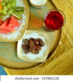 Nutritious and healthy food to eat before breaking Roza - a fast during holy month in Islam. Dates, milk, fruits and rose flavored sharbat.