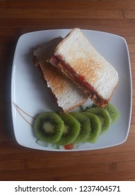 Nutritious and healthy peanut butter and jelly toast with sliced fresh kiwi. An easy and satisfying snack or breakfast.