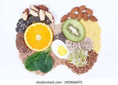 Nährstoffhaltige natürliche Inhaltsstoffe in Schilddrüsenform. Gesunde Lebensmittel als Quelle von Vitaminen und Mineralien. Probleme mit dem Schilddrüsenkonzept