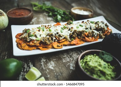 Nutritious Sweet Potato Loaded Nachos with salsa and guacamole