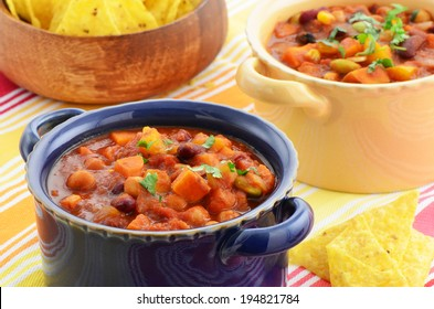 Nutritious vegetarian chili full of tomato, beans, peppers, sweet potato and corn