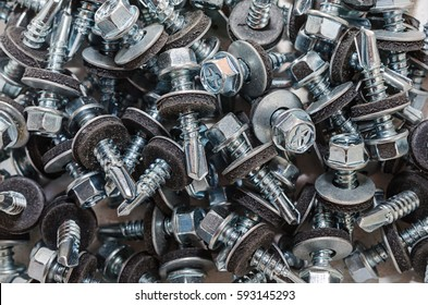 Nuts Bolts screws closeup. Background