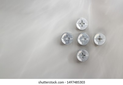 Nuts for connecting bolt on gray metallic background, space for text, flat lay, top view