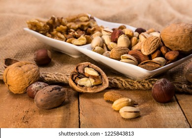 Nuts of different varieties, pistachios, almonds on the background of burlap