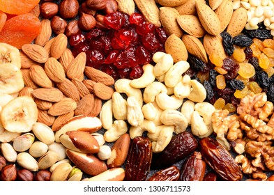 Nuts and dried fruits assortment on stone table. Healthy breakfast and snack concept. Top view.