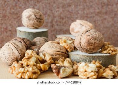 Nuts and honey photoset. Honey, walnut, cinnamon, sawed wood.