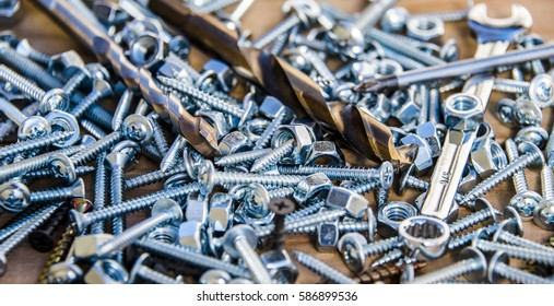 nuts, screws and drill bits made of metal