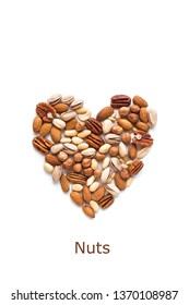 Nuts in shape of Heart isolated on white. Various nuts (almonds, pistachios, pecans, hazelnuts, pine nuts, peanuts).