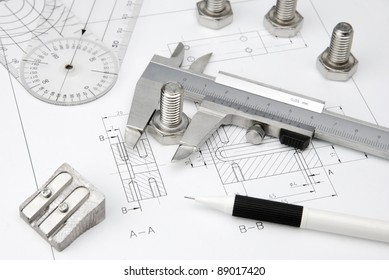nuts wrench and caliper on technical drawing