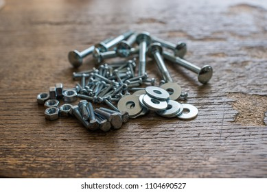nuts,bolts and washers on wooden background