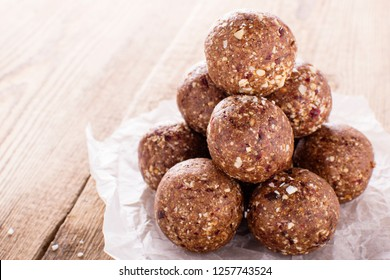 nutty chocolate energy balls on parchment paper