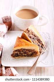 Nutty pastries on plate and cup of coffee