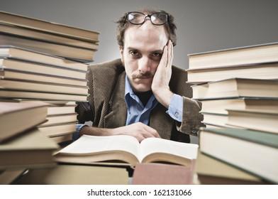 Nutty Professor in between stacks of books